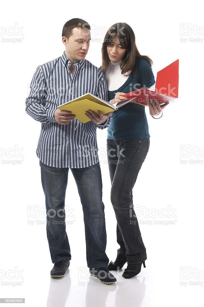 Two people looking at books royalty-free stock photo