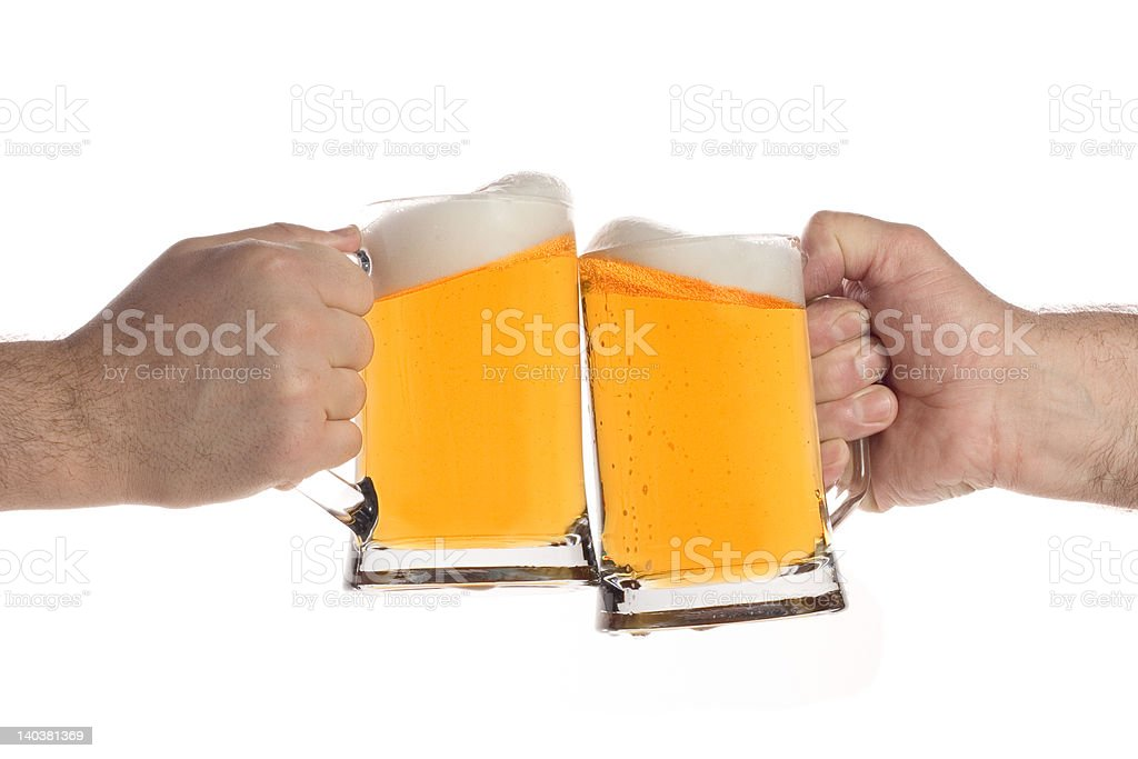 Two people making a toast with beer mugs royalty-free stock photo