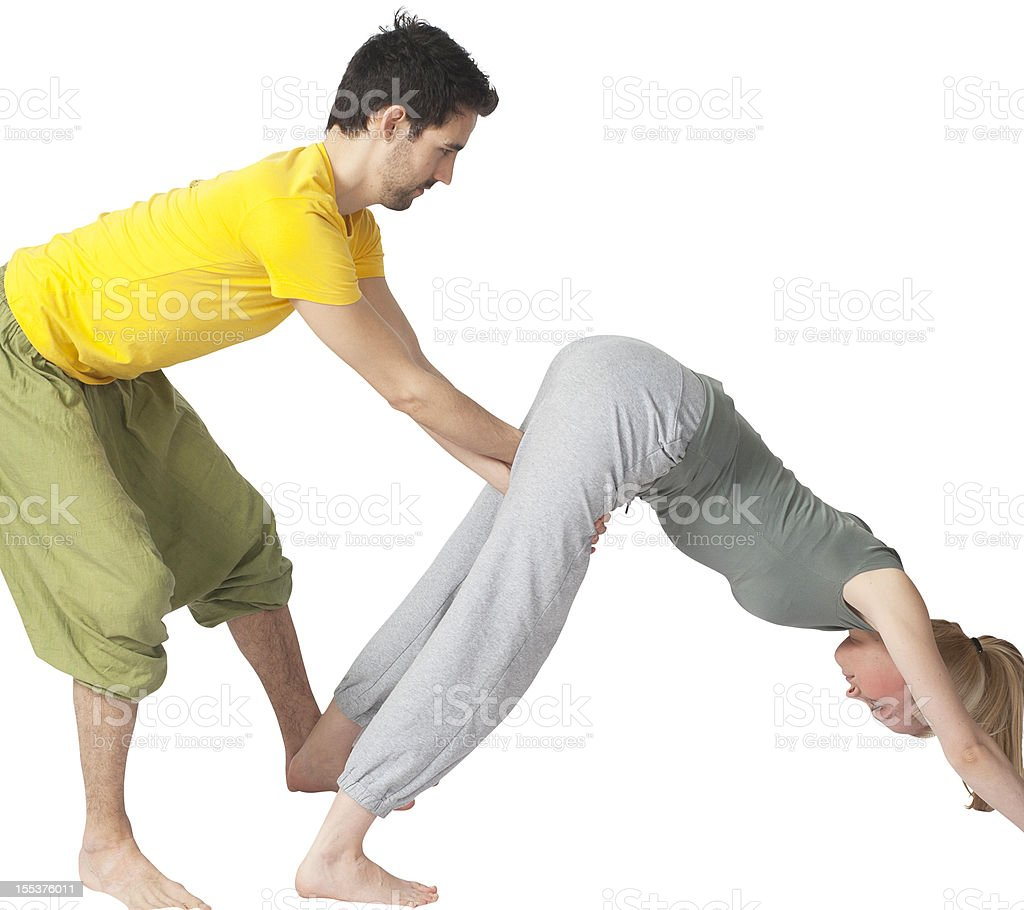 Two people making yoga together stock photo