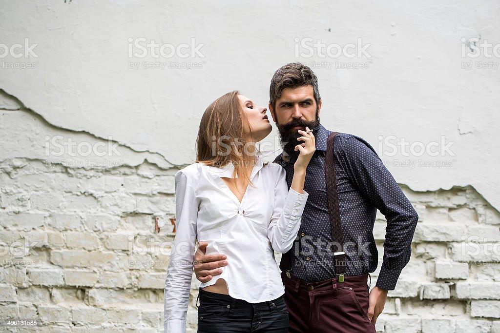 Two people near wall stock photo