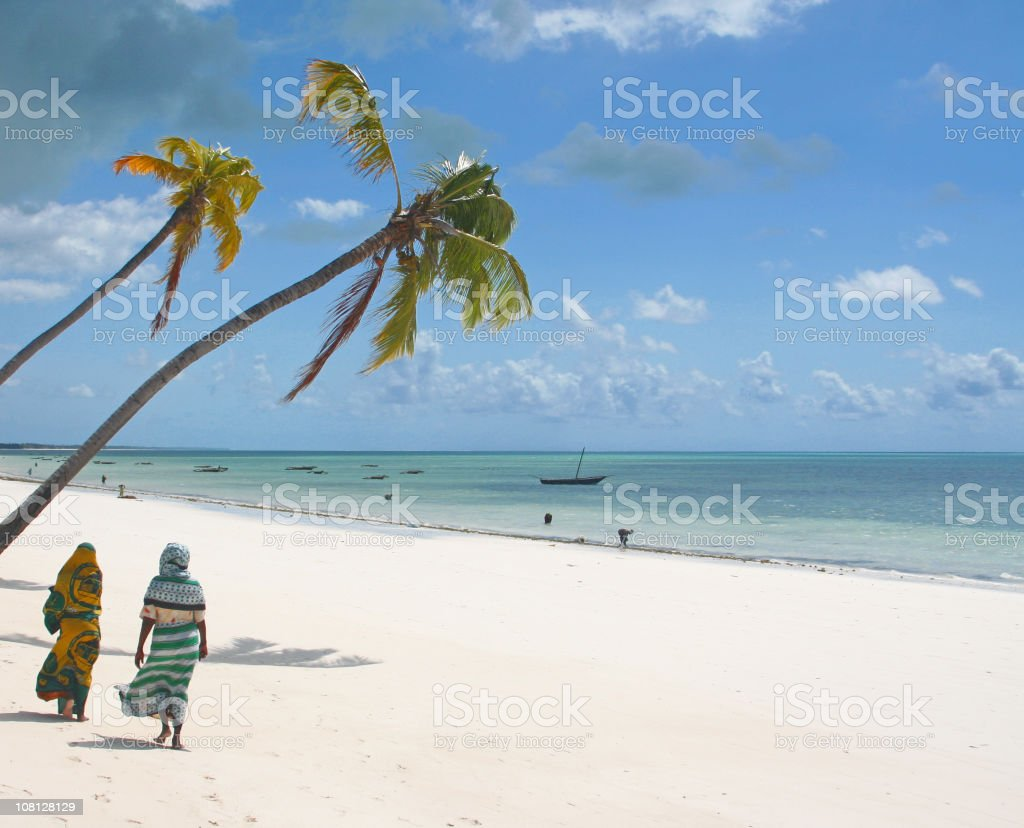 Two people on an African beach stock photo
