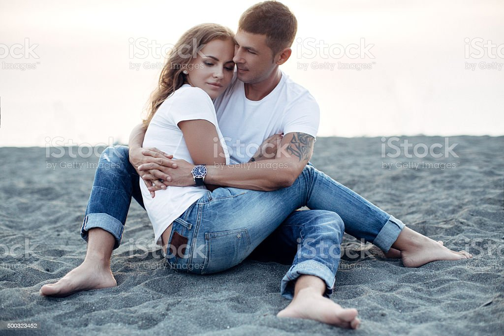 Two people on the background of sea coast stock photo