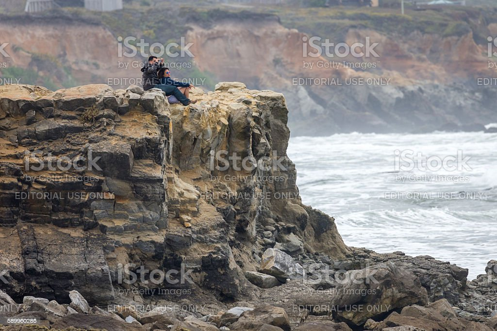 Two people on the coastline near Santa Cruz, California stock photo
