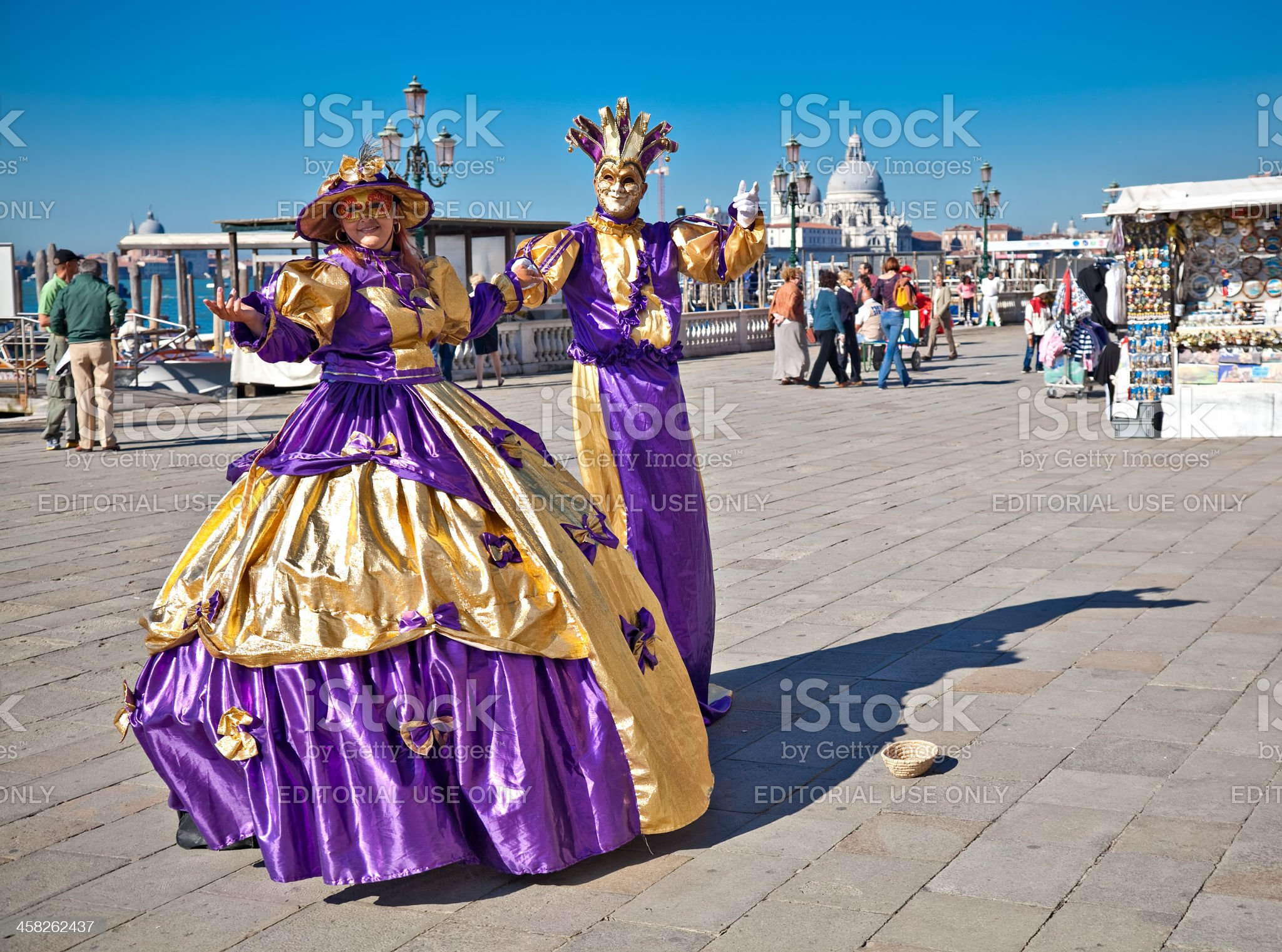 Two people on the Venetian quay dressed in carnival costumes. royalty-free stock photo