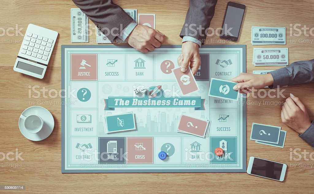 Two people playing a board game stock photo