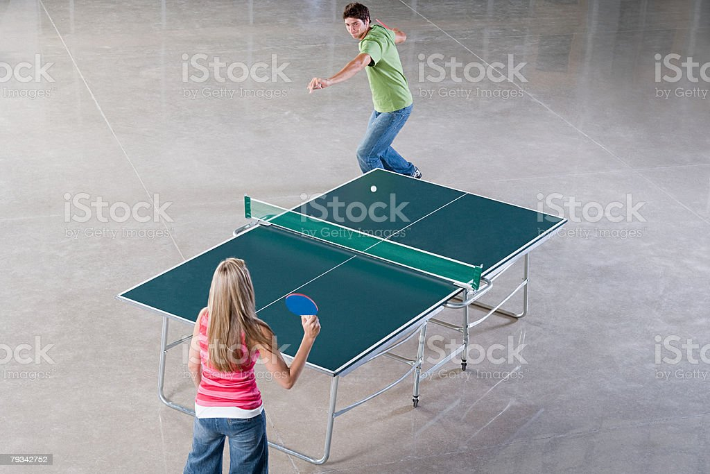 Two people playing table tennis royalty-free stock photo