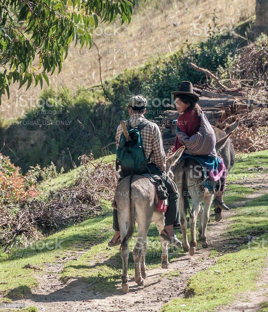 Two People Riding Donkeys Near Huaraz, Peru stock photo