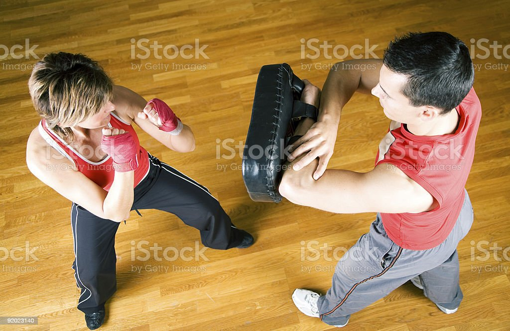 Two people sparring in martial arts class stock photo