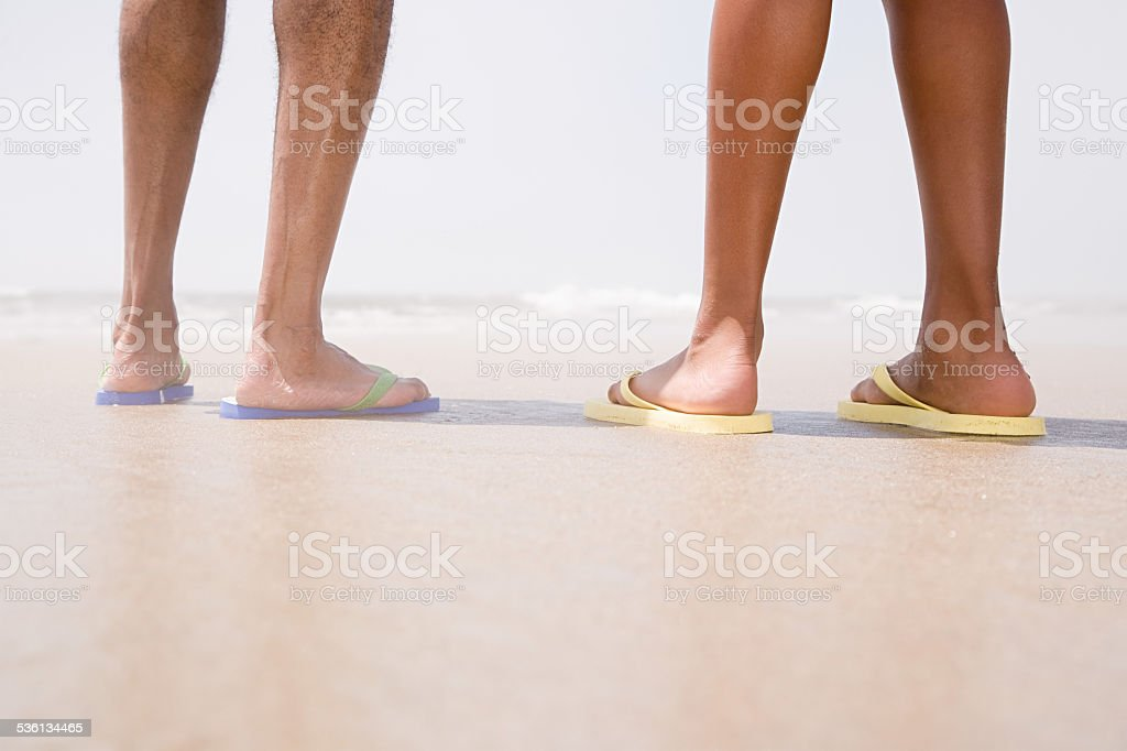 Two people standing on a beach stock photo