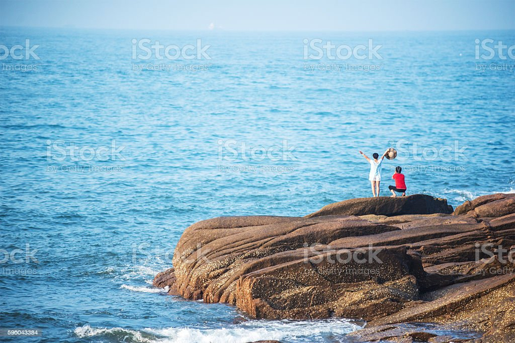 Two people standing on top of a mountain stock photo