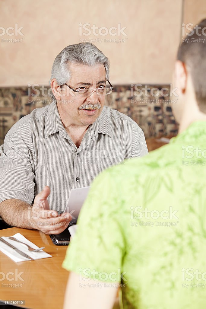 Two people talking business during lunch hour royalty-free stock photo