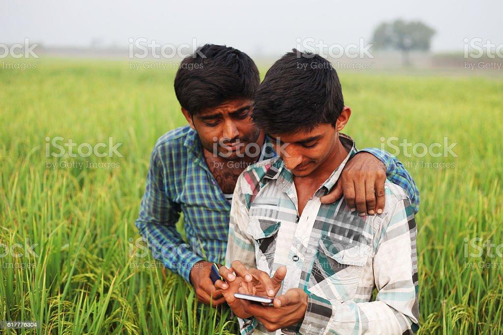 Two people using digital display smart phone stock photo