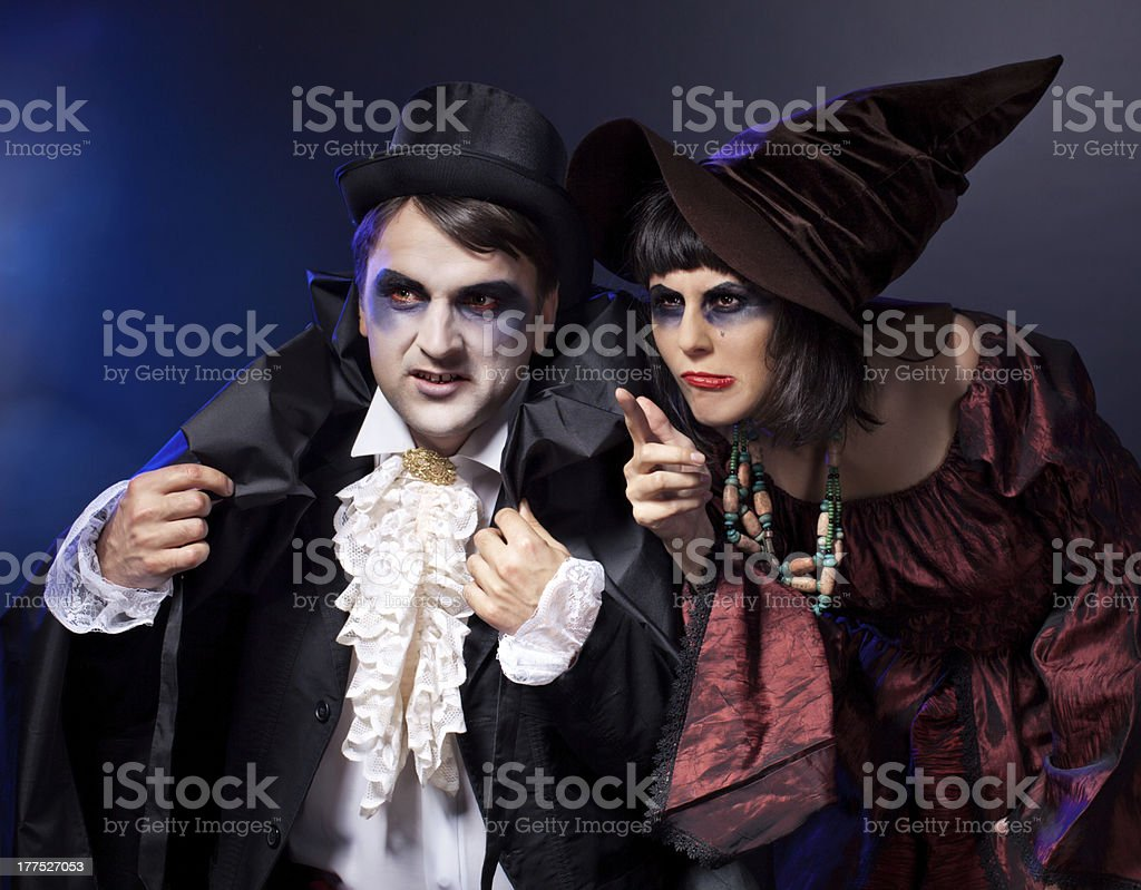 two people  wearing  as  vampire and witch. Halloween royalty-free stock photo