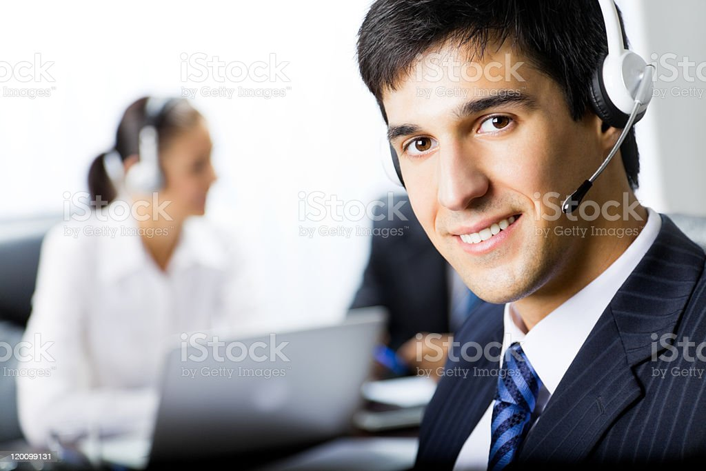 Two people with telephone headsets at workplace royalty-free stock photo