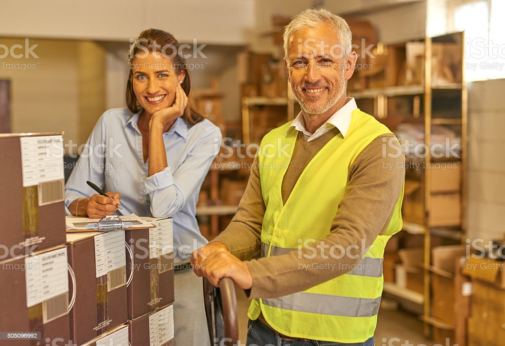 Two people working in  warehouse stock photo