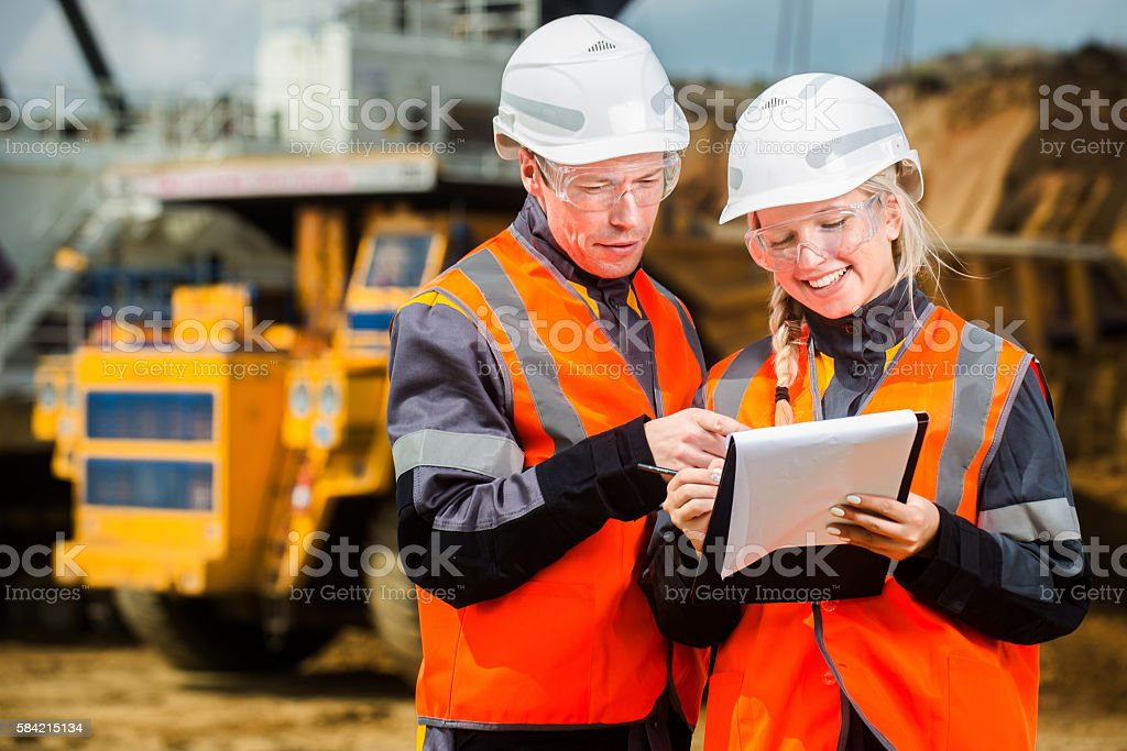 Two people working stock photo