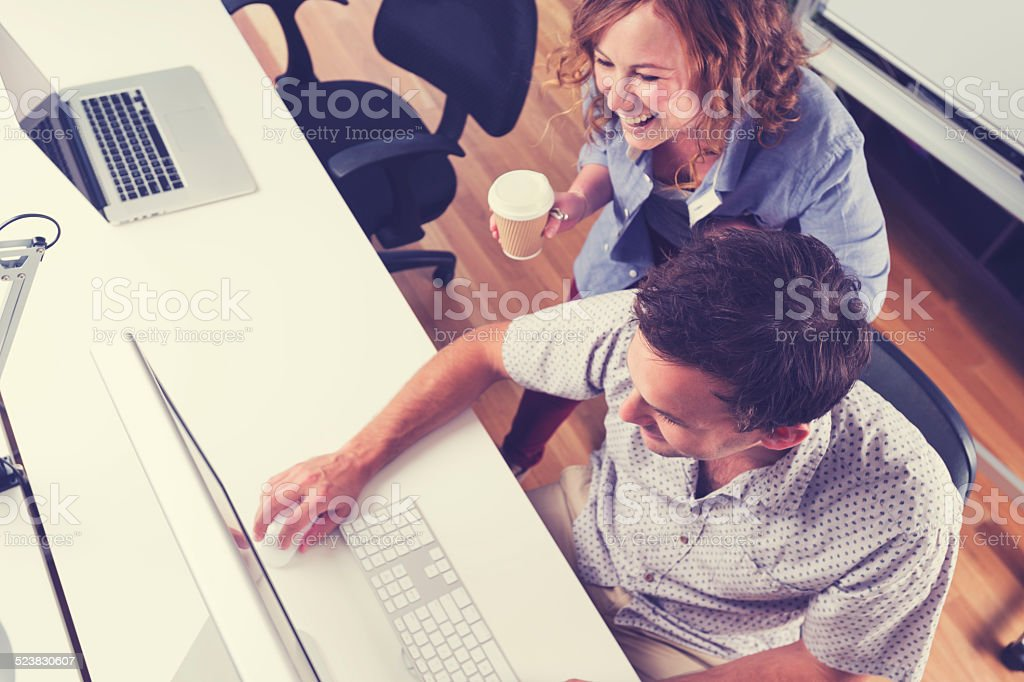 Two people working together with computer. stock photo