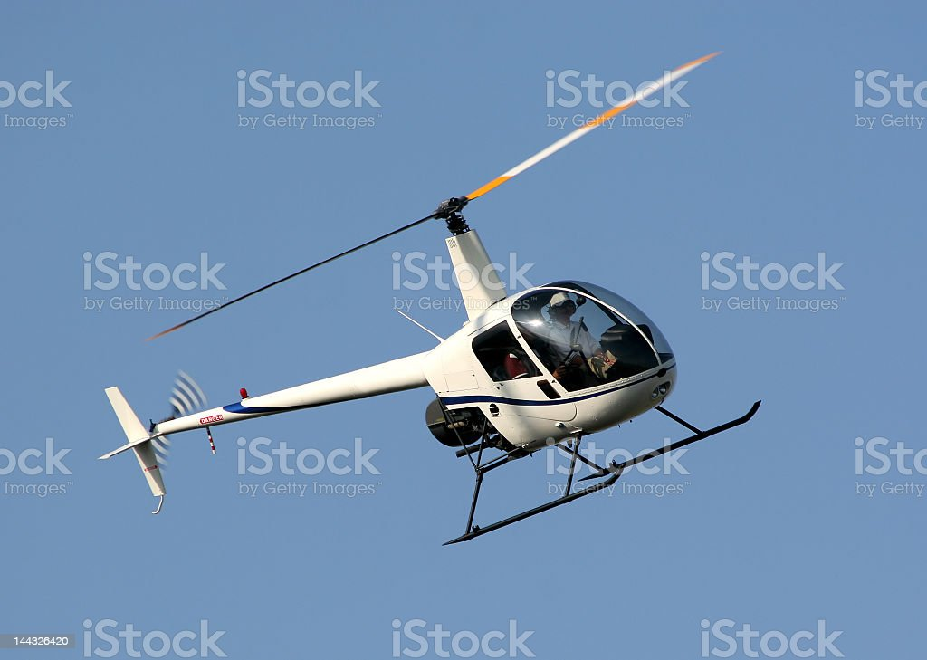 Two person helicopter flying in the sky stock photo