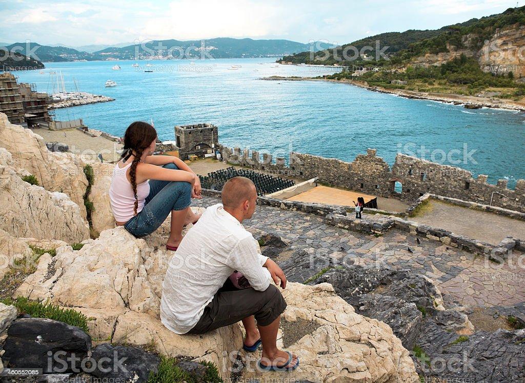 Two persons contemplating Portovenere. stock photo