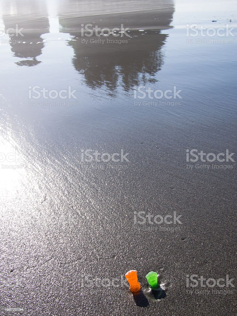 Two Person-Shaped Candies Stand on Rialto Beach stock photo