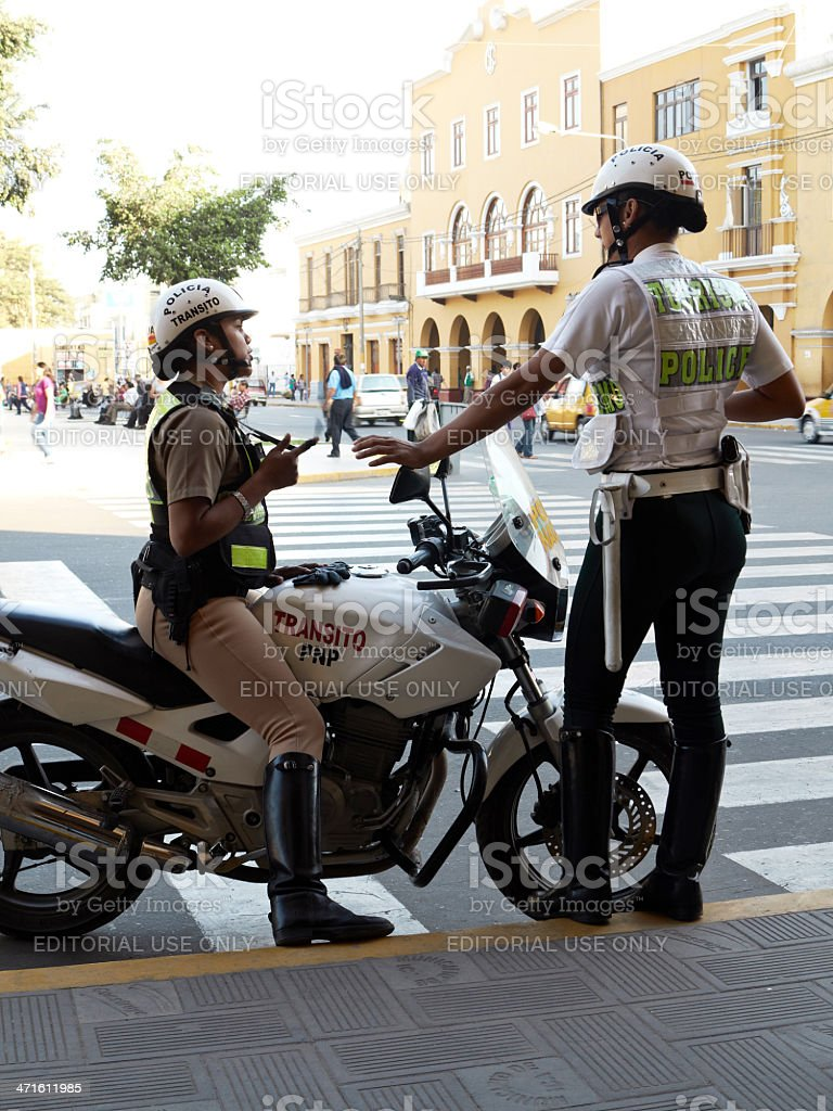 Two Peruvian  policewomen on duty royalty-free stock photo