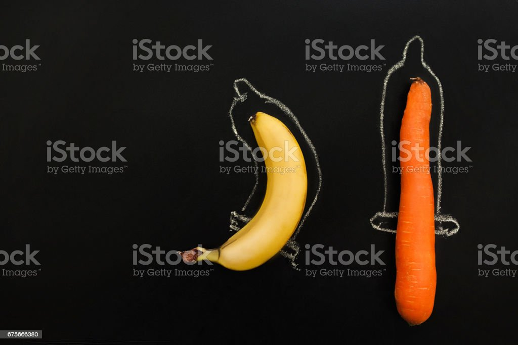 Two phallus in condoms, different shape of penis stock photo