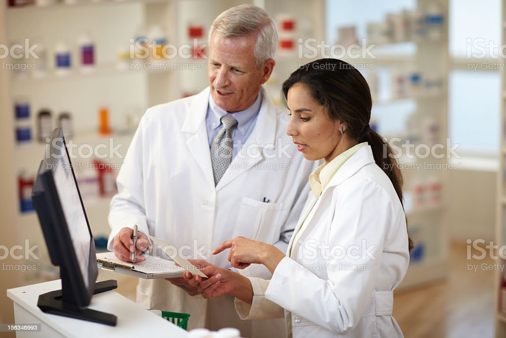 Two Pharmacist Filling royalty-free stock photo