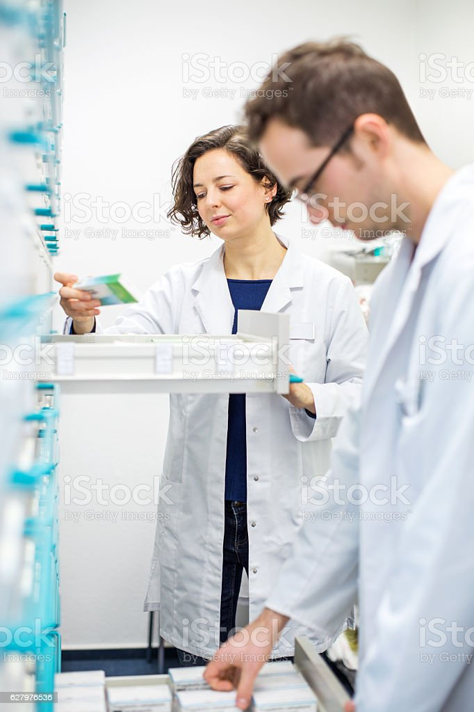 Two pharmacists looking for prescription medication stock photo