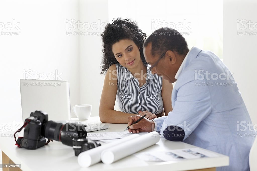 Two photographer filling a contract form royalty-free stock photo