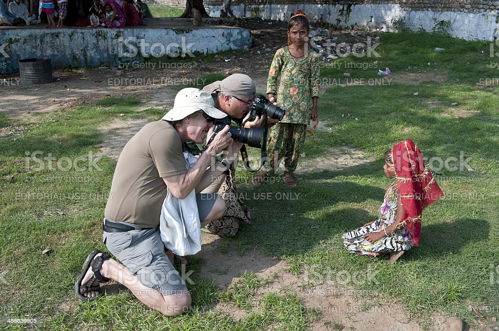 Two Photographers and Indian Girls in Jammu royalty-free stock photo