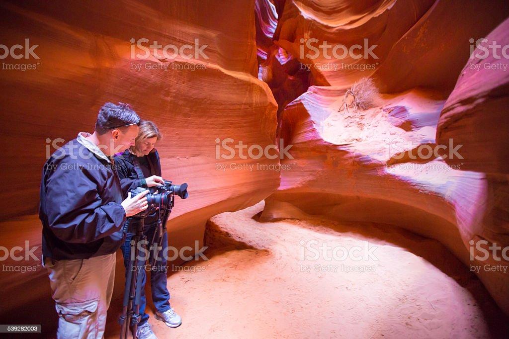 Two photographers photograph Antelope Canyon stock photo