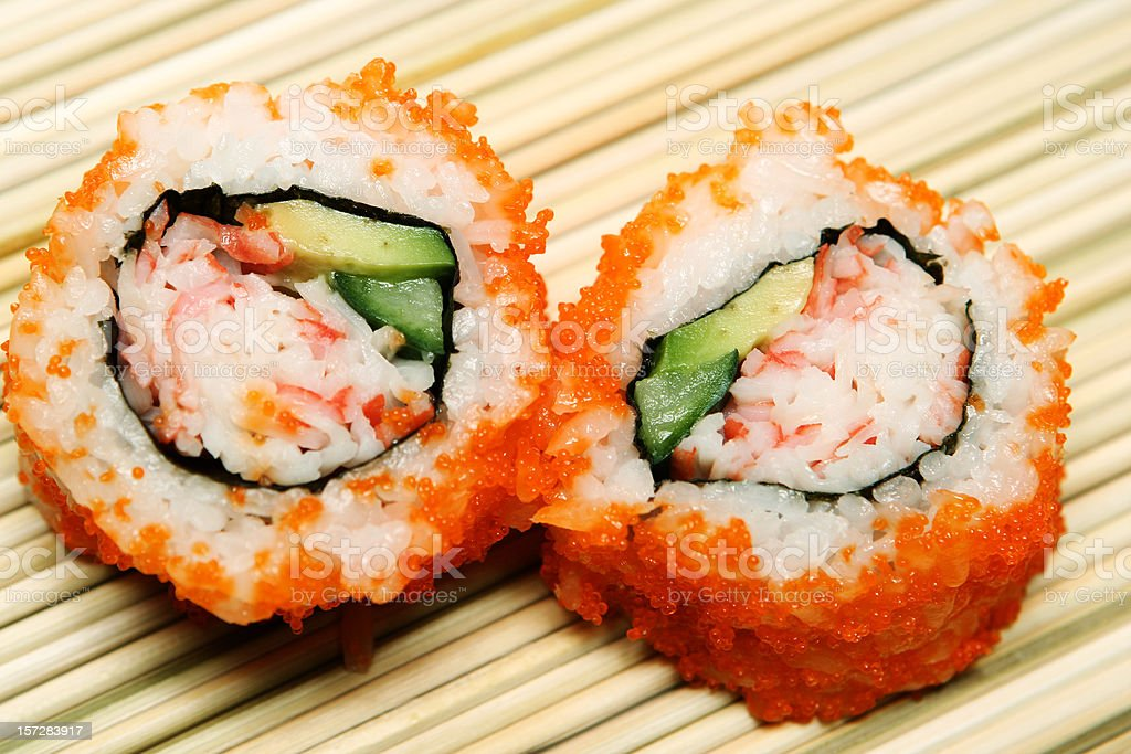 Two Pieces of California Rolls royalty-free stock photo