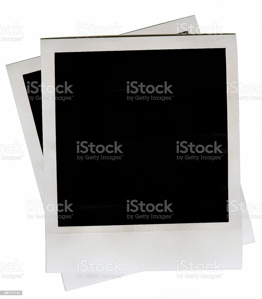 two pieces of instant film royalty-free stock photo