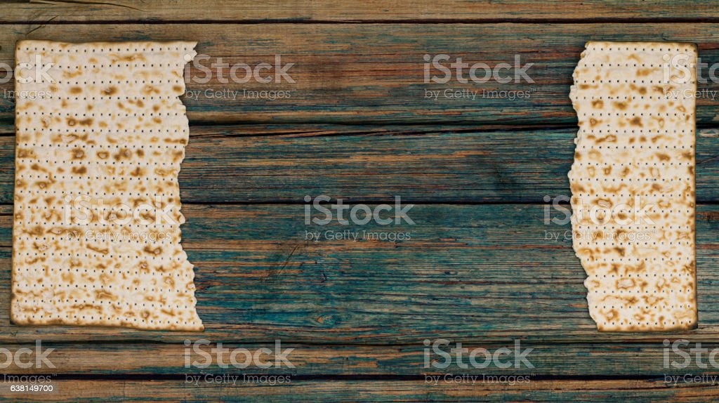 Two pieces of matzah on a vintage wood background stock photo