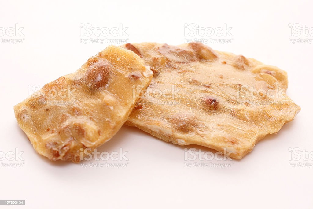 two pieces of peanut brittle royalty-free stock photo