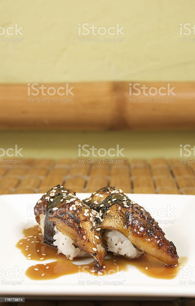 two pieces of unagi under bamboo royalty-free stock photo