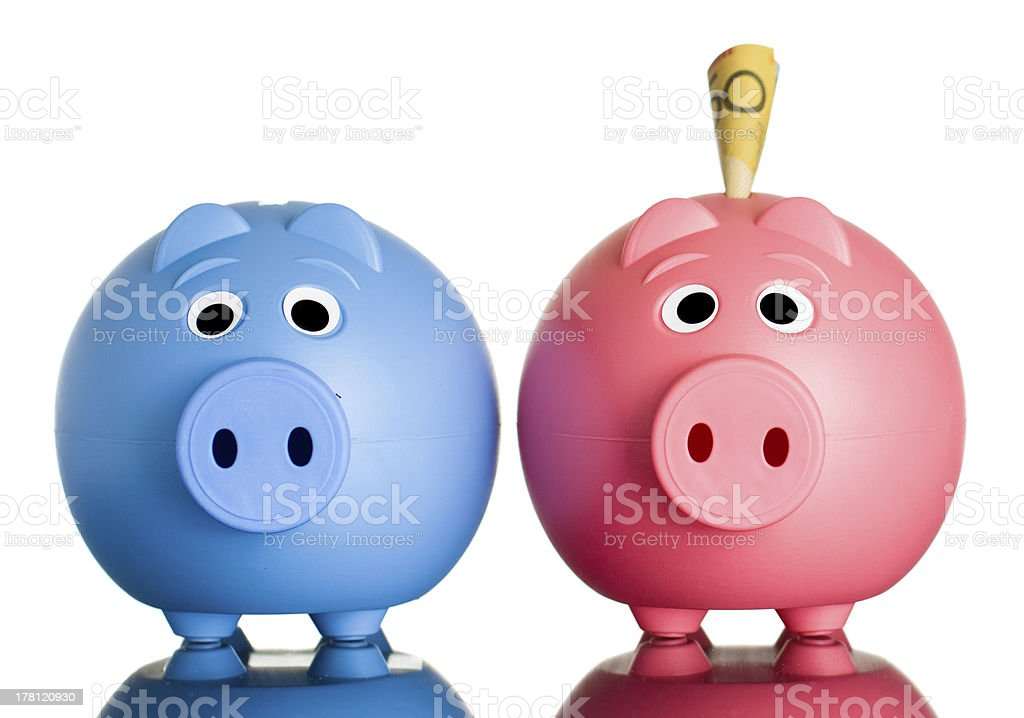 Two piggy banks with money in one. royalty-free stock photo