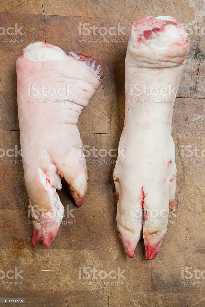 Two pig's trotters stock photo