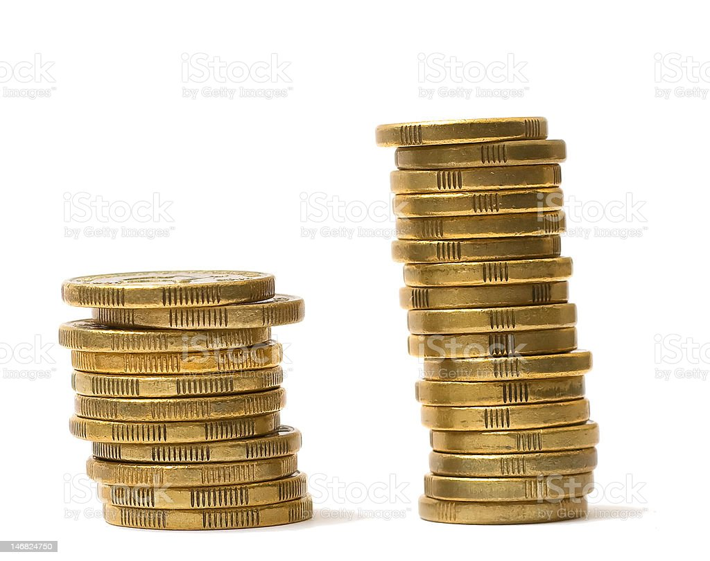 two piles of gold coins on white background stock photo