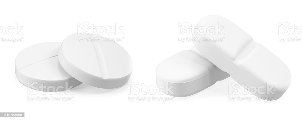 Two pills isolated on white background. stock photo