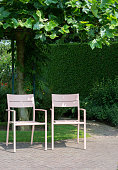 two pink seats in garden