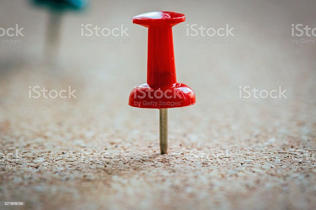 Two pins on corkboard stock photo