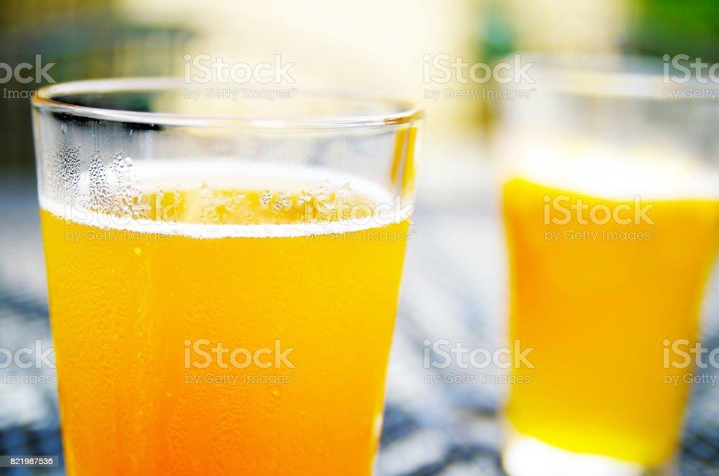 Two pints of hefeweizen stock photo