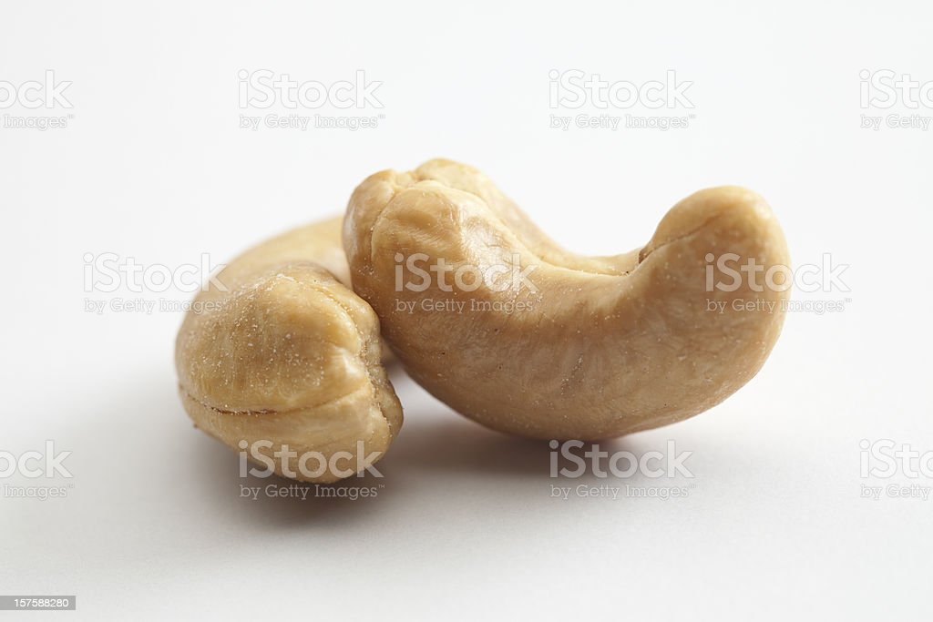 Two plain cashew nuts on a white background  stock photo