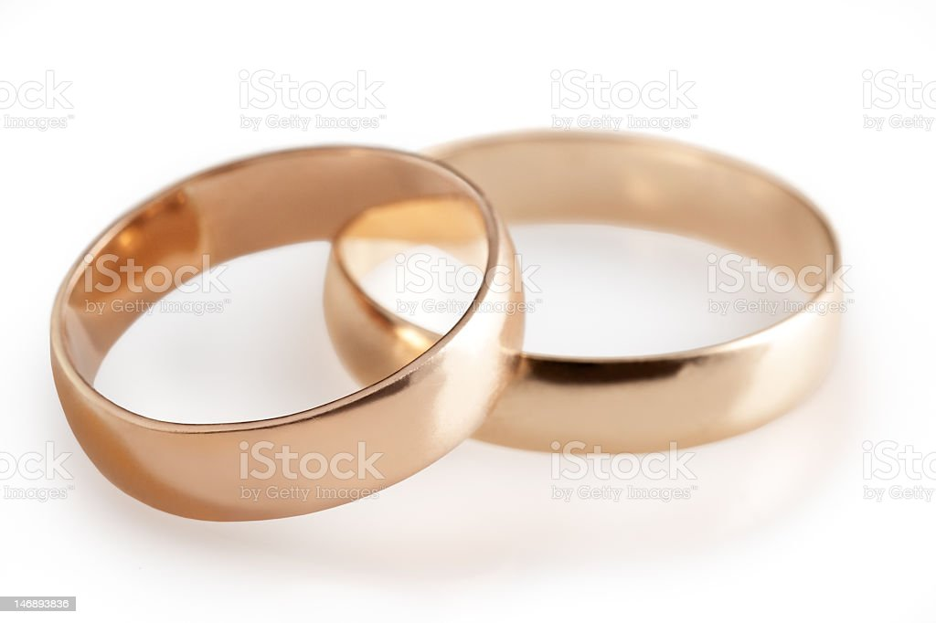 Two plain gold wedding bands overlapping stock photo