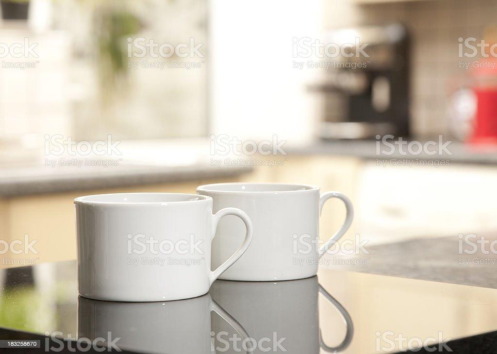 Two plain white coffee cups stock photo