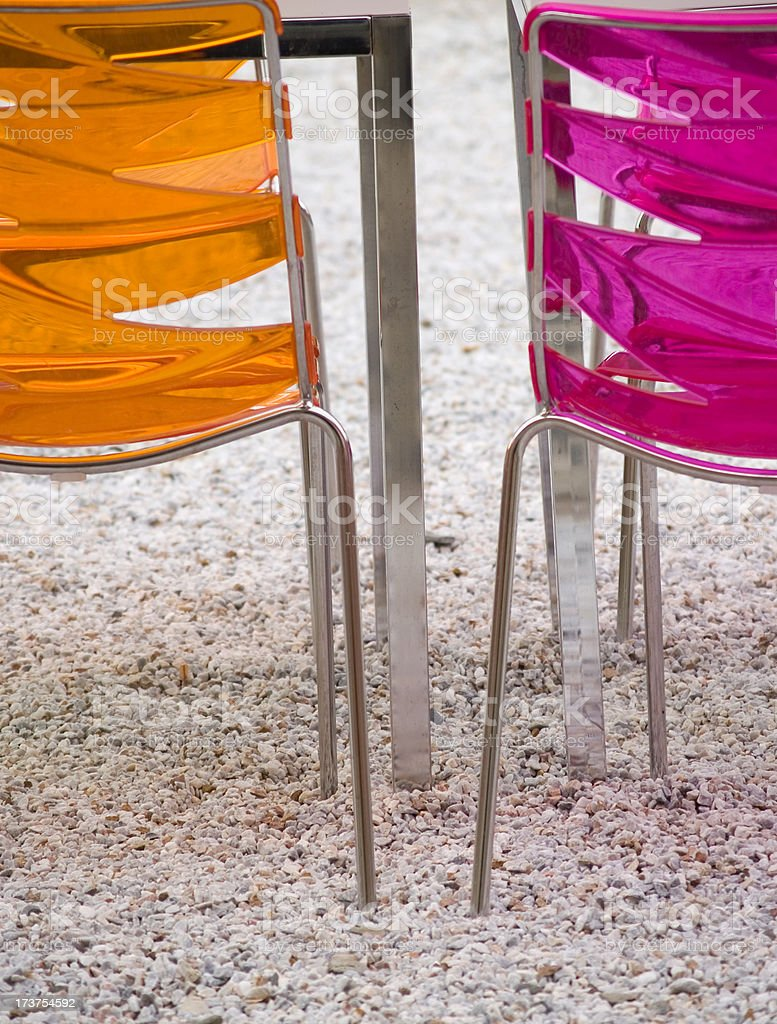 Two plastic chairs stock photo