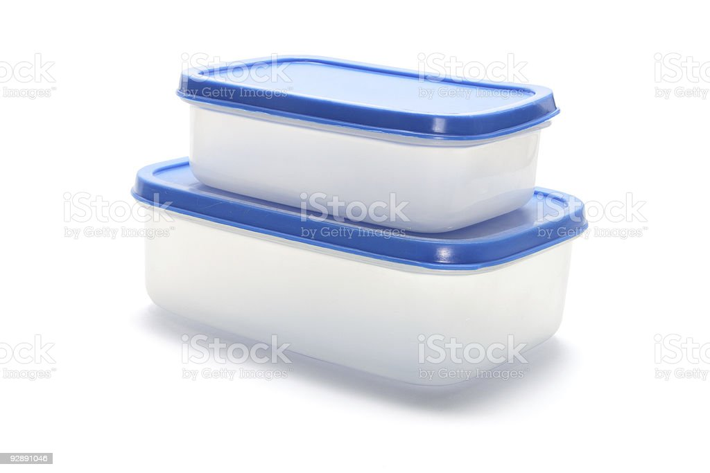 Two plastic containers with blue lids stacked on each other royalty-free stock photo