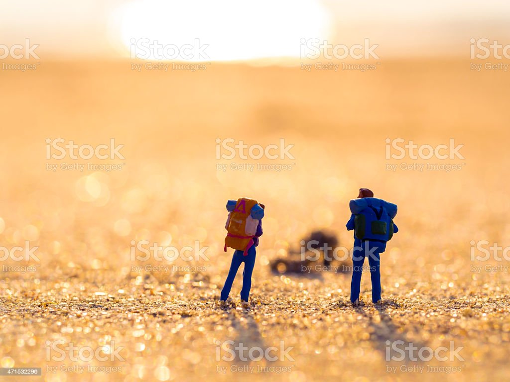 two plastic toys with back pack stock photo