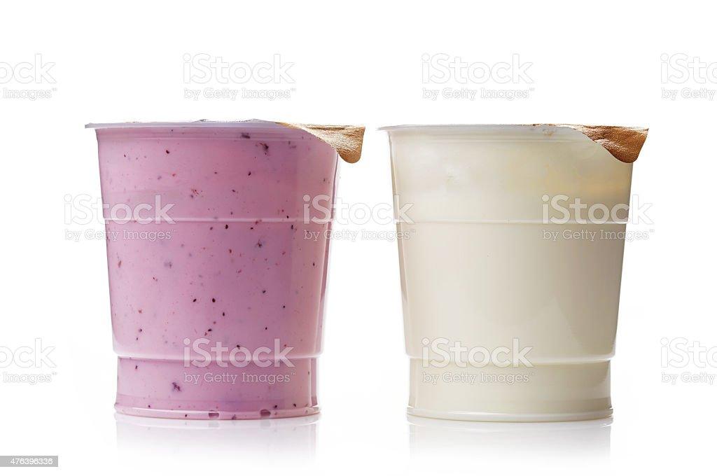two plastic yogurt pots stock photo